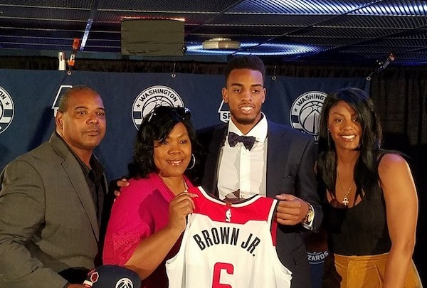 Washington Wizards top draft pick Troy Brown Jr. poses for pictures with (from left) parents Troy Brown Sr. and Lynn Brown and sister Jada Brown during a June 25 press conference at Capital One Arena in D.C. to introduce Brown to the media. (William J. Ford/The Washington Informer)