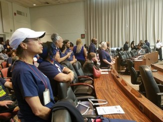 Dozens of educators with the Prince George's County Educators Association attend a June 7 school board meeting in Upper Marlboro, chanting and demanding more accountability and transparency in the school system. (William J. Ford/The Washington Informer)
