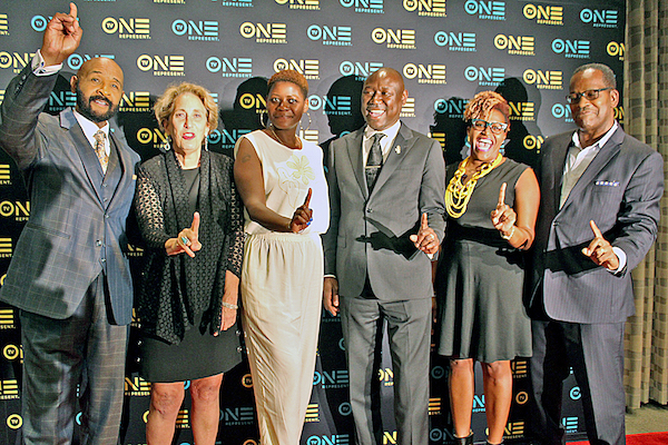 """From left: Rushion McDonald, Linda Lipsen, Chantá Parker, Benjamin Crump, Tia Smith and Mike Fletcher grace the red carpet at the premiere of """"Evidence of Innocence"""" at the NCTA headquarters in northwest D.C. on May 31. (Brigette White/The Washington Informer)"""