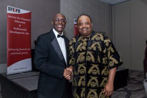 Ted Daniels (left), founder and president of Society for Financial Education and Professional Development, poses with journalist Roland Martin at the organization's 20th anniversary gala. (Courtesy photo)