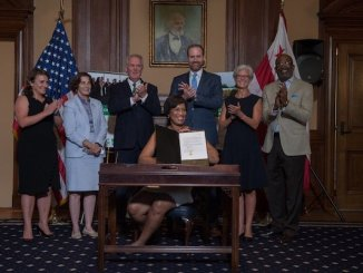 D.C. Mayor Muriel Bowser on July 10 signs the District of Columbia Green Finance Authority Establishment Act of 2018, officially making Washington, DC the first city in the United States to establish a green bank. (Courtesy of Bowser's office via Twitter)