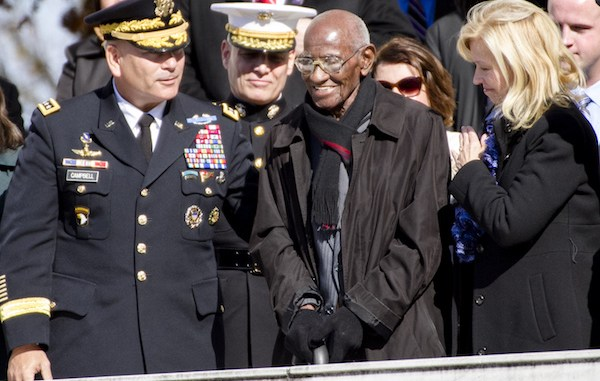 **FILE** Richard Overton stands as President Barack Obama acknowledges him as America's oldest living World War II veteran during a Veterans Day ceremony at Arlington National Cemetery on Nov. 11, 2013. (Staff Sgt. Sean K. Harper/Army News Service)