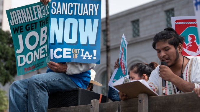 Protesters at a pro-immigration rally where organizers called for a stop to the Immigration and Customs Enforcement (ICE) raids and deportations of illegal immigrants and to officially establish Los Angeles as a sanctuary city. Los Angeles, California February 18, 2017. (Photo by Ronen Tivony/NurPhoto via Getty Images)