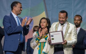 Ethiopian Prime Minister Dr. Abiy Ahmed (second from right) receives the Ethiopia Day proclamation from Ambassador Kassa Takleberhan, Ethiopian Ambassador to the U.S., while Ethiopian first lady Zinash Tayachew joins in the applause. (Photo by Khalid Naji-Allah)
