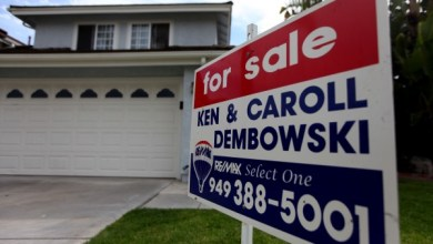 **FILE** A For sale sign sits in front of homes on a hillside in San Clemente, California on Wednesday, August 25, 2010. July new home sales fell to their lowest level since 1963 due to a weaker than expected economic recovery. (Photo by Sandy Huffaker/Corbis via Getty Images)