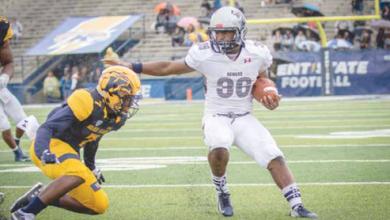 Howard University's Dedrick Parson avoids the defense on the way to a 74-yard touchdown run. (Photo by David Sierra)