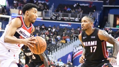 Washington Wizards forward Otto Porter Jr. drives against Miami Heat guard Rodney McGruder during the Wizards' 121-114 preseason win at Capital One Arena in D.C. on Oct. 5. (John De Freitas/The Washington Informer)