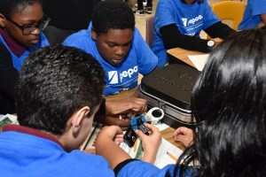 Students from Oxon Hill and Thomas Johnson middle schools attempt to open a box with a few locks during STEM activities at the Howard B. Owens Science Center in Lanham, Maryland, on Oct. 10. (William J. Ford/The Washington Informer)
