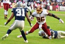 Washington Redskins running back Adrian Peterson attempts to juke Dallas cornerback Byron Jones during the Redskins' 20-17 win at FedEx Field at Landover, Md., on Oct 21. (John E. De Freitas/The Washington Informer)