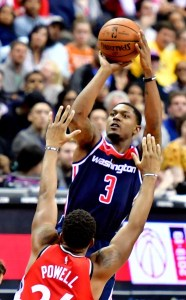 Washington Wizards guard Bradley Beal shoots over Toronto Raptors forward Norman Powell during the Raptors' 117-113 win at Capital One Arena in D.C. on Oct. 20. (John E. De Freitas/The Washington Informer)