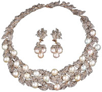 Signed Buccellati pearl and rose-cut diamond leaf design choker and matching drop earrings from the estate of Gladys Bendetsen auctioned by Sloans & Kenyon for $47,200 on Sept. 17, 2006.