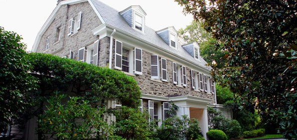 Topped by a slate room, the 1904 stone house is entered from a circular driveway.