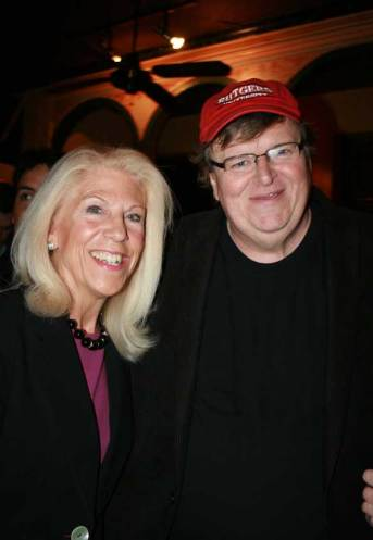 "Michael Moore with Kandy Stroud at the opening of ""Capitalism: A Love Story."""