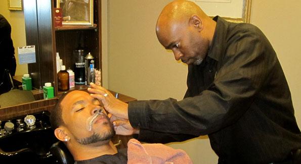 Devin Thomas and Robert Andrew celebrity master barber Derek Williams.