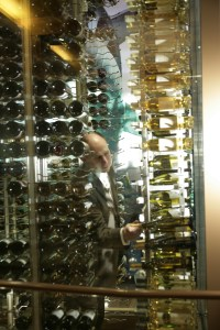 General Manager / Sommelier Brian Zipin selects a bottle of wine from Central's cellar.