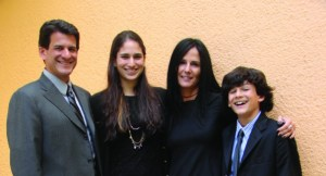Husband Carlos Bachrach, Camille Bachrach, Deborah Kalkstein, and Kevin Bachrach outside their family home. (photo by: John Heale)