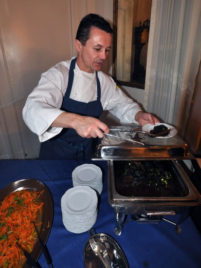 Chef Patrick Moulet of the Petits Plats restaurant serves braised short ribs