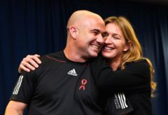 Husband and wife team Andre Agassi and Steffi Graf share a loving embrace before hitting the courts.