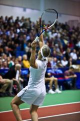 Martina Navratilova excutes a strong first serve during the WTT Smash Hits at American University's Bender Arena.