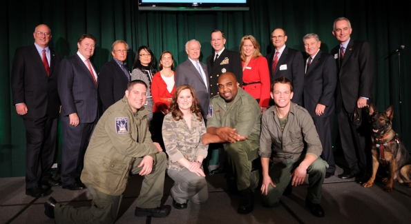 Grants with Admiral Mullen and Newman's Own Foundation CEO Bob Forrester, and musical performers 4Troops. Photo Courtesy of Kimball Stroud.