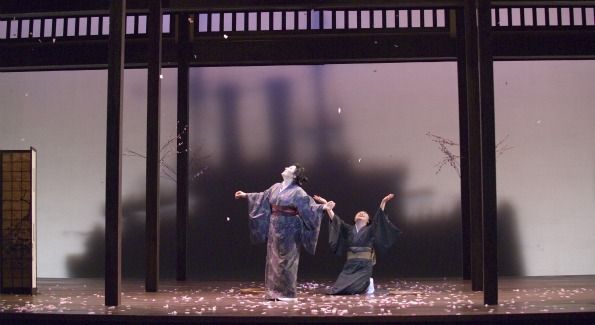Madame Butterfly under falling cherry blossoms. Image courtesy of the San Francisco Opera.