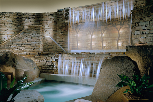 The interior pool and Jacuzzi features hydro waterfalls.