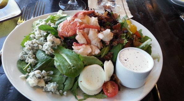 The Lobster Cobb Salad at Harvest is topped with a mound of succulent shellfish. Photo courtesy of Kelly Magyarics.