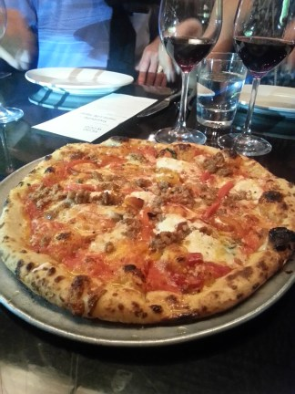 The sausage and fennel wood-fired pizzas is a menu highlight at Redd-Wood. Photo courtesy of Kelly Magyarics.