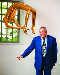 "Tony Podesta with one of his favorite works, Louise Bourgeois' ""Arch of Hysteria"" sculpture. (Photo by Joseph Allen)"