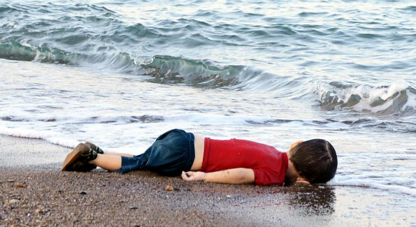 This photo of young Syrian boy Aylan Shenu drowned on a Turkish beach, after a boat carrying refugees to the Greek island of Kos, sank, sparked outrage around the world. It was a wake-up call to many, a tragedy that captured the severity of the worst migrant crisis since World War II. (Credit: AFP Photo/Nelufer Demir/Dogan News Agency)