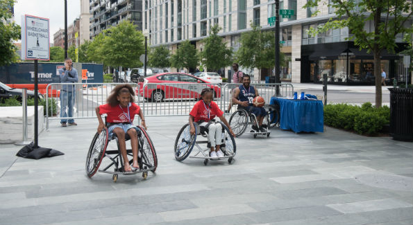 Harsh Thakkar, NHR Punishers Wheelchair Basketball Captain, teaching DC youth from the local Boys and Girls club