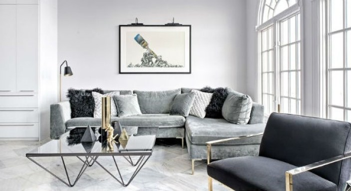 the marble floored living area showcases an original art piece by celebrated pop artist mr brainwash untitled an artistic iteration of the marine