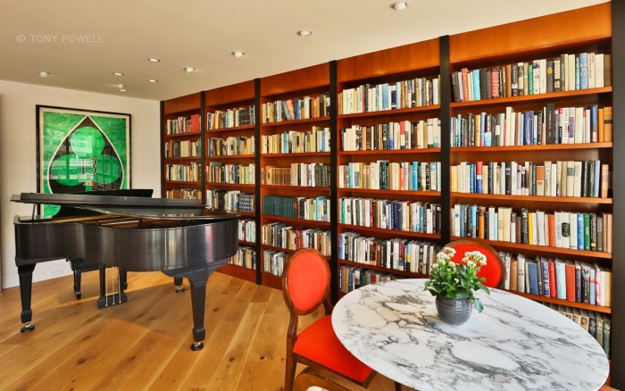 books are displayed in the library living room and study a piano provides entertainment when guests play during parties and artworks include the number