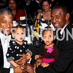 Photo by Tony Powell. Reggie Stanley, Zoe and Malena Stanley-Galloway, Rocky Galloway. 14th Annual HRC Dinner. October 9, 2010
