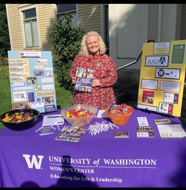 WSC member Rachel serving with University of Washington in Seattle poses with literature outside