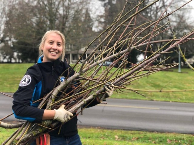 WSC member Ashley holding a large tree branch