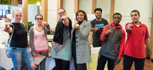 Council Members Alice Gannon-Boss (3rd from left) and Khadija Wallace (4th from left) enjoy apples with WCC students