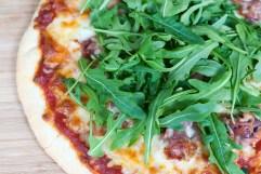 ARUGULA: Arugula prosciutto pizza