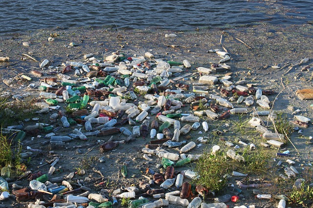 Image shows the tide of waste on a beach to illustrate the floating rubbish dump, marine pollution problem.