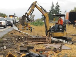Image shows a conventional non NRMM emissions reduction compliant excavator.