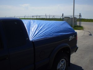 Example of a pickup truck following the Covered Loads Policy.