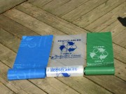 Recycling equipment available includes colored bags for easy separation of items.