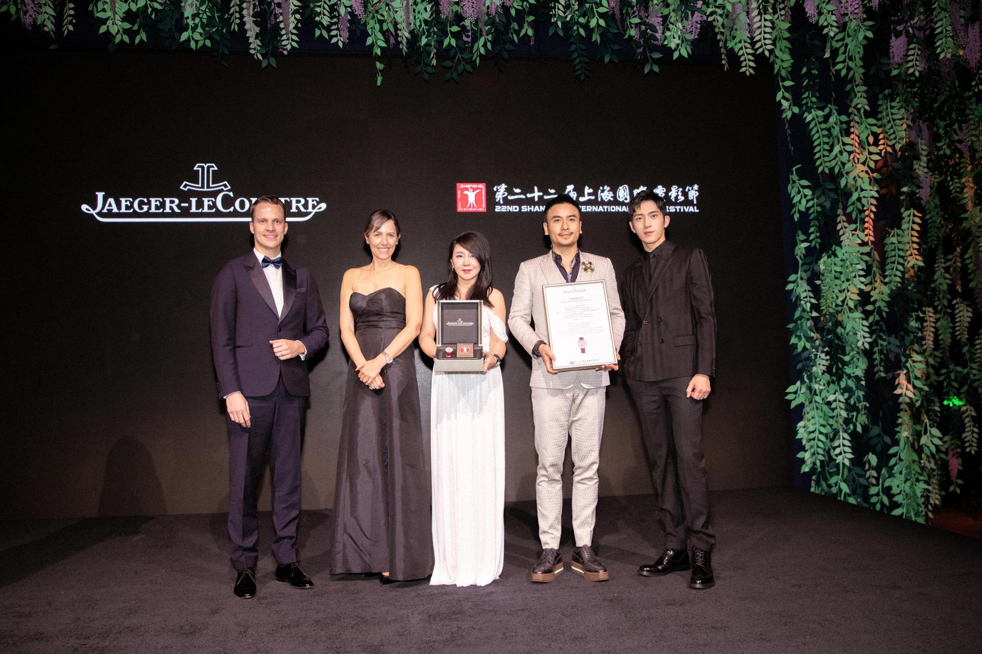 Charity autcion - Maxence Kinget, Catherine Rénier, auction winner, Jing Boran (from left to right)