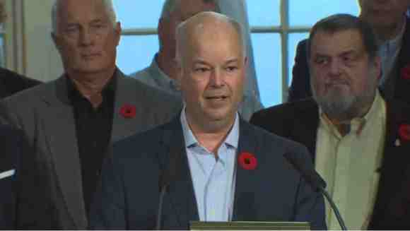 Jaime Baillie stood with PC MLAs as he said he was stepping down as party leader. (CBC)