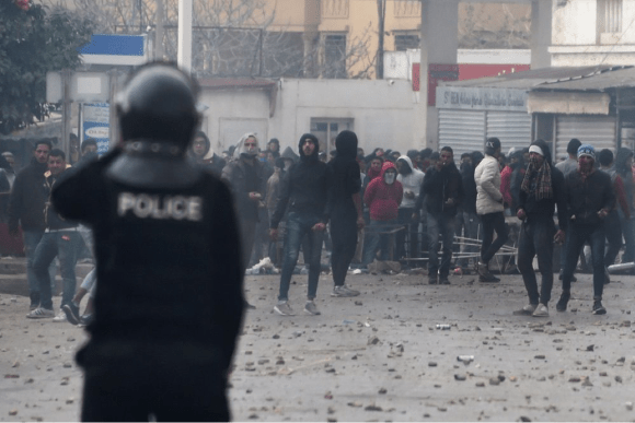 Tunisian protesters clash with security forces in the town of Tebourba on Jan. 9, 2018. (Courtesy Fethi Belaid/AFP/Getty Images)