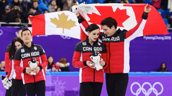 Canada's Scott Moir, right to left, Tessa Virtue, and Patrick Chan celebrate their gold medal victory in the team figure skating event at the Pyeonchang Winter Olympics on Feb. 12, 2018. (Courtesy Paul Chiasson/The Canadian Press)
