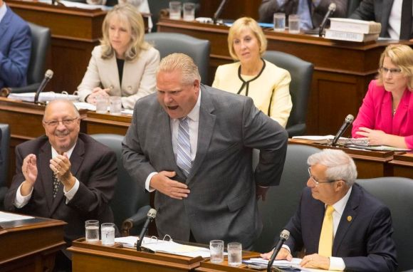 Doug Ford taking a bow on July 30th after bragging about his election win  (Courtesy Chris Young/The Canadian Press)