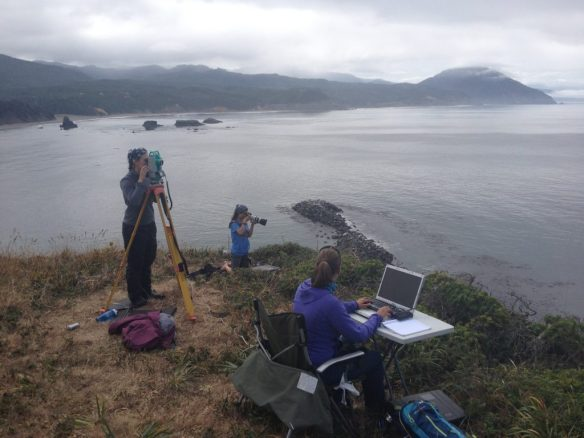 Our field team in Port Orford. The theodolite is the tall instrument which marks whale and vessel positions. Computer takes records while photographer identifies individuals.