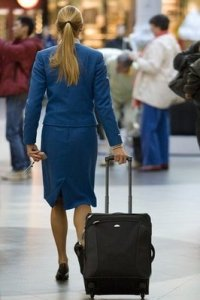 airline employee with suitcase