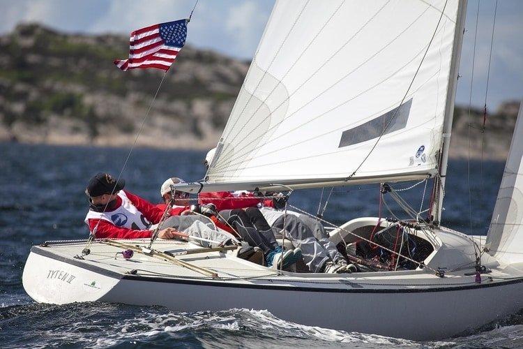 sailboat racing flying us flag